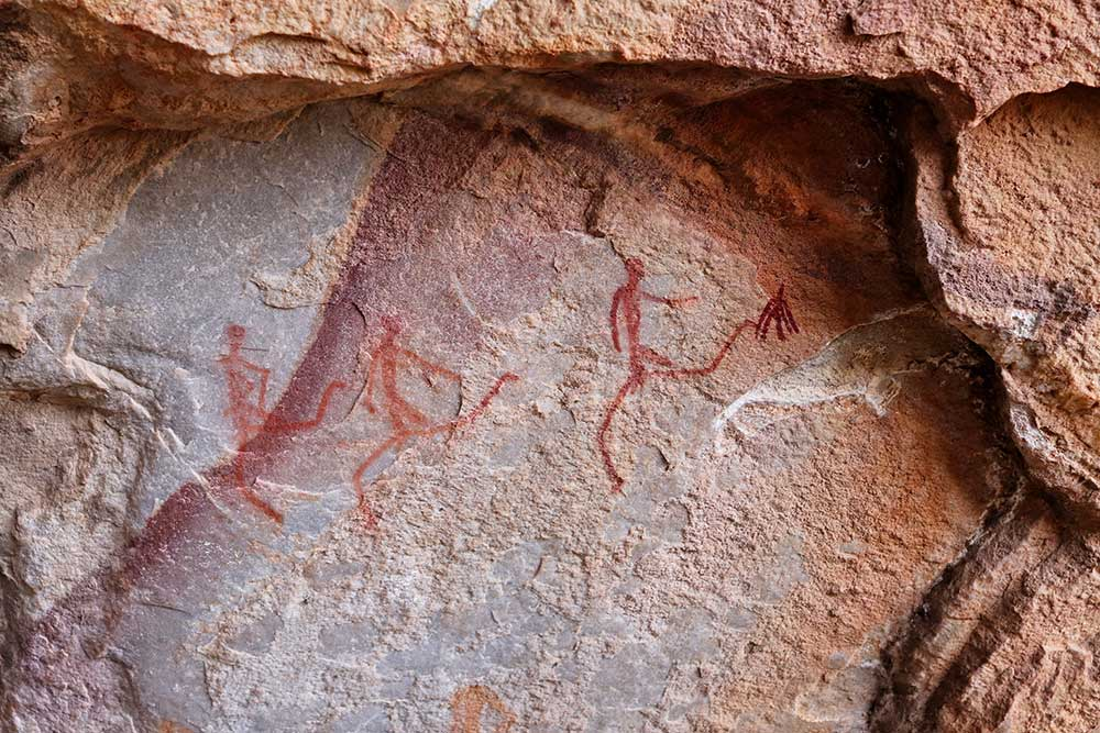 Archaeologists have discovered over 300 cave painting galleries dating from the Palaeolithic era, not one of which contains depictions of warfare, weapons or warriors.